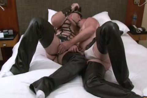 Persons Dressed Up In bondage Gear get Each Others Peckers Licked And Suction.