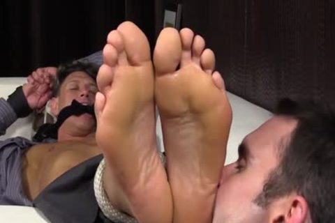 Bryce Evans Is tied Up And Has His Toes Licked On The daybed