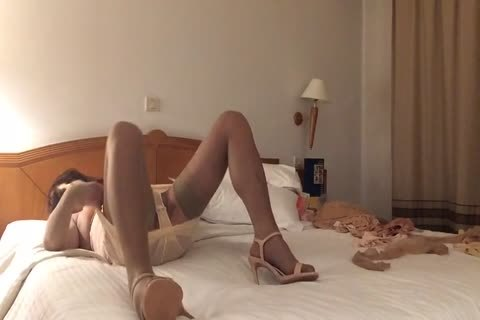 fake penis In nude stockings And High Heels