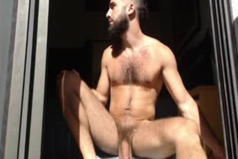Bearded lad Massages his testicles