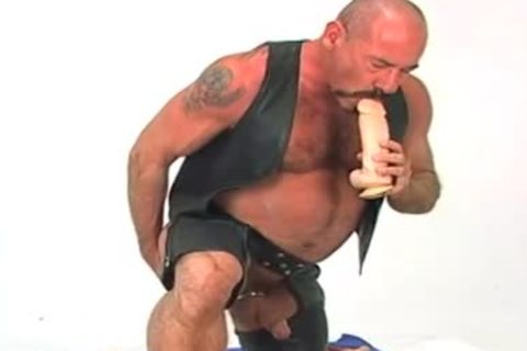 Butch leather wearing aged chap w/ giant sex-toy